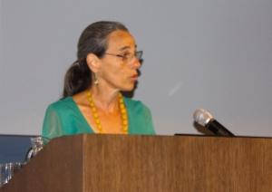 Raquel speaking at podium